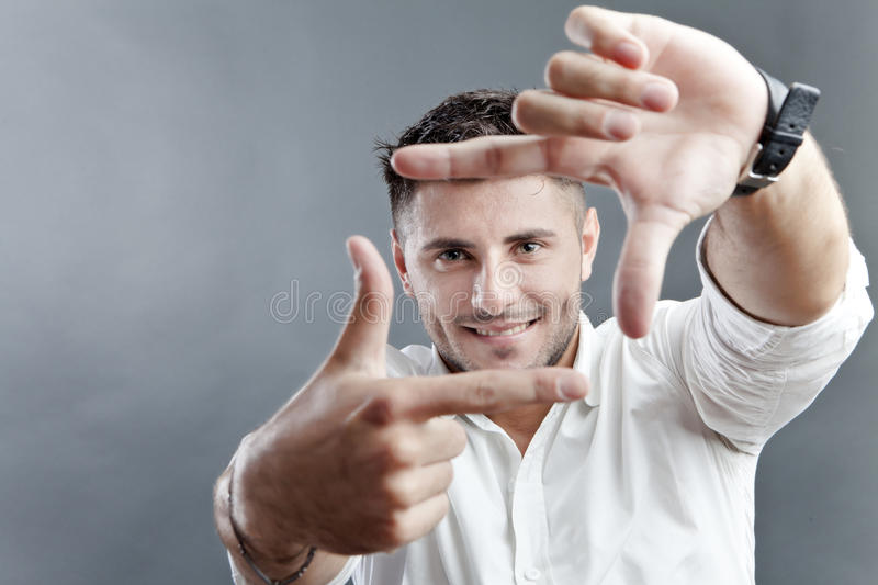 Happy man framing face stock photography
