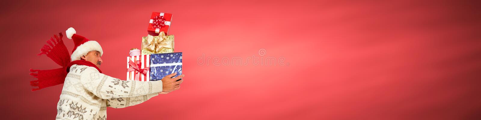 Happy man with gifts. Happy caucasian man running with Xmas gifts royalty free stock images