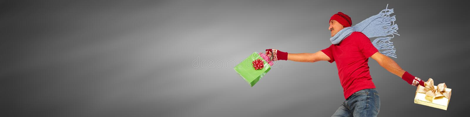 Happy man with gifts. Happy caucasian man running with Xmas gifts stock photos
