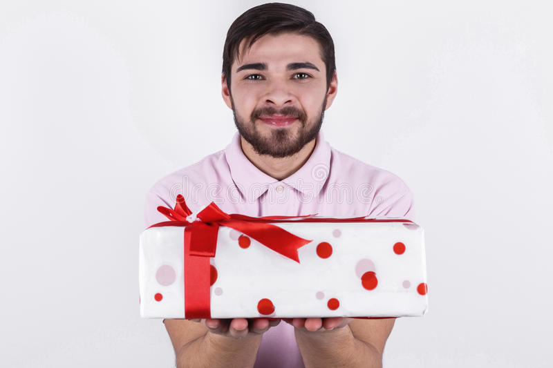 Happy man with gifts on special day stock photos