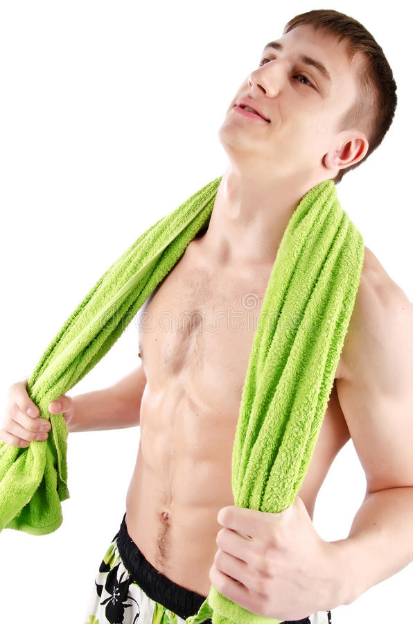 Happy man with green towel stock photos
