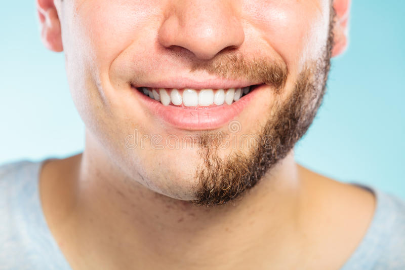 Happy man with half shaved face beard hair. Closeup of happy man with half shaved face beard hair. Smiling guy on blue. Skin care and hygiene royalty free stock photography