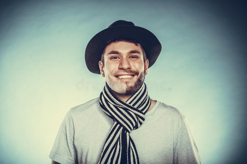 Happy man with half shaved face beard hair in hat. Portrait of happy man with half shaved face beard hair in hat and scarf. Smiling handsome guy on blue. Skin stock photos