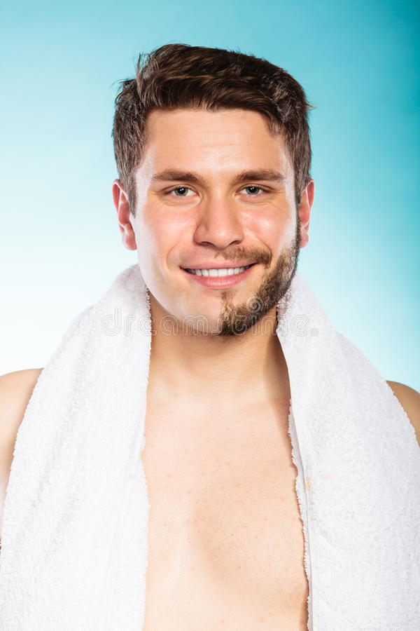 Happy man with half shaved face beard hair. Portrait of happy man with half shaved face beard hair. Smiling handsome guy on blue. Skin care and hygiene royalty free stock image