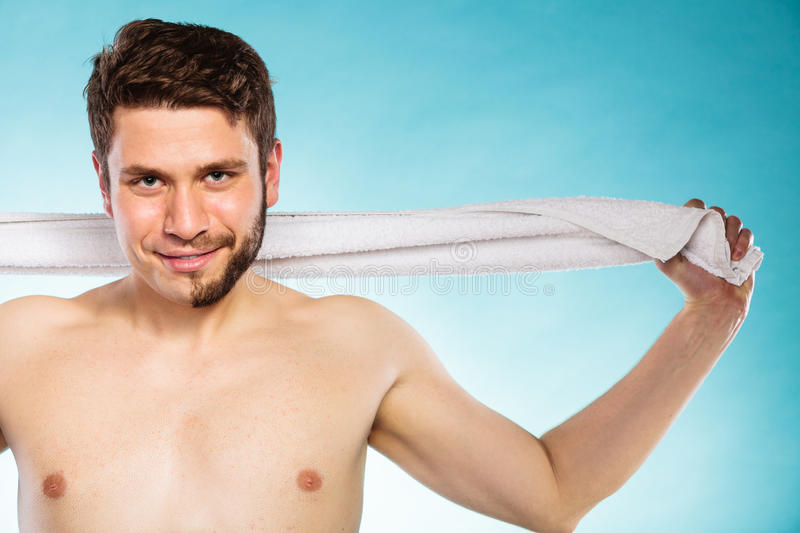 Happy man with half shaved face beard hair. Portrait of happy man with half shaved face beard hair. Smiling handsome guy on blue. Skin care and hygiene stock image