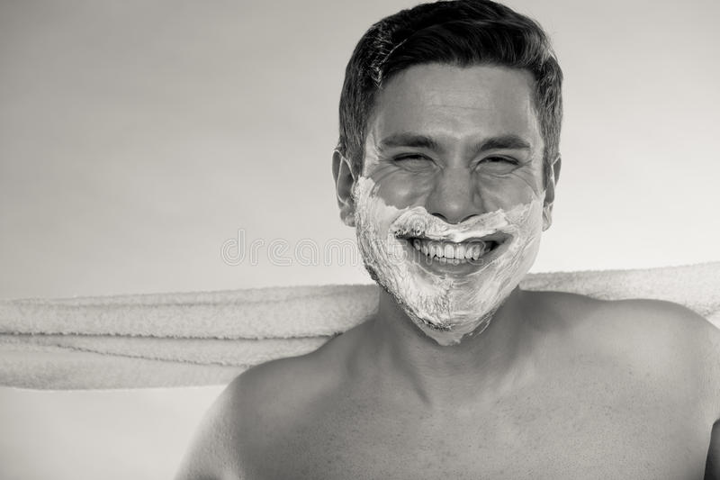 Happy man with half shaved face beard hair. Portrait of happy man with half shaved face beard hair. Smiling handsome guy on blue. Skin care and hygiene. Black royalty free stock photos