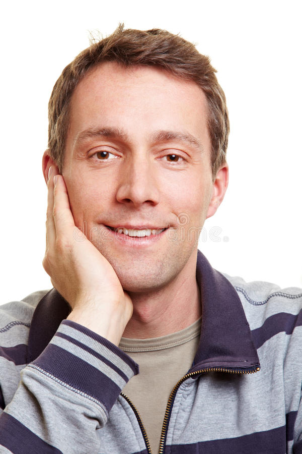 Happy man with hand on chin stock image