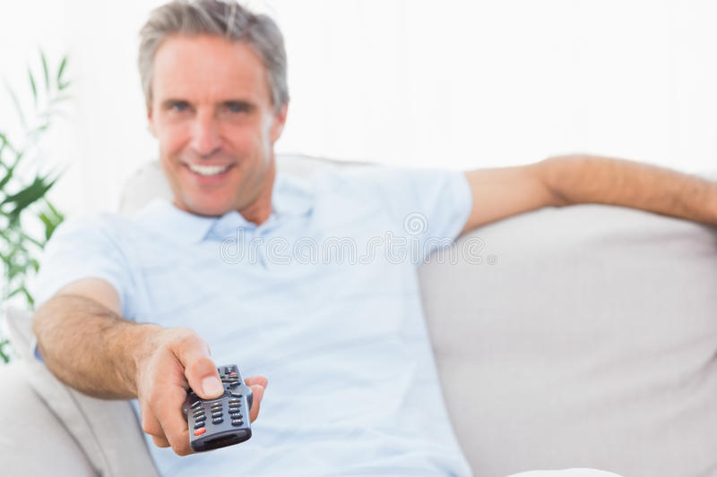 Happy Man On His Couch Watching Tv Royalty Free Stock Photo