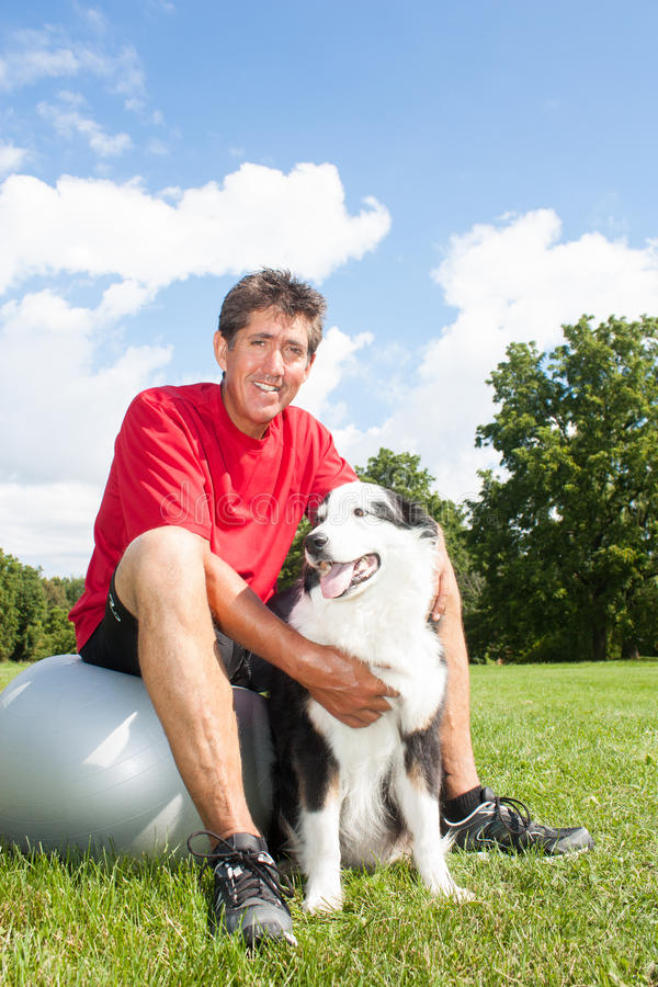 Happy man and his dog royalty free stock photo