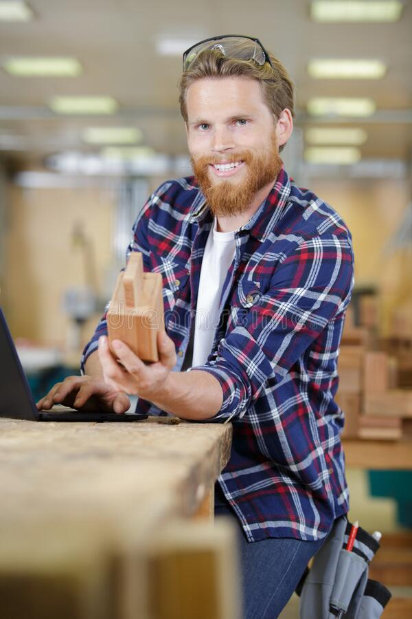 Happy man holds piece wood royalty free stock images