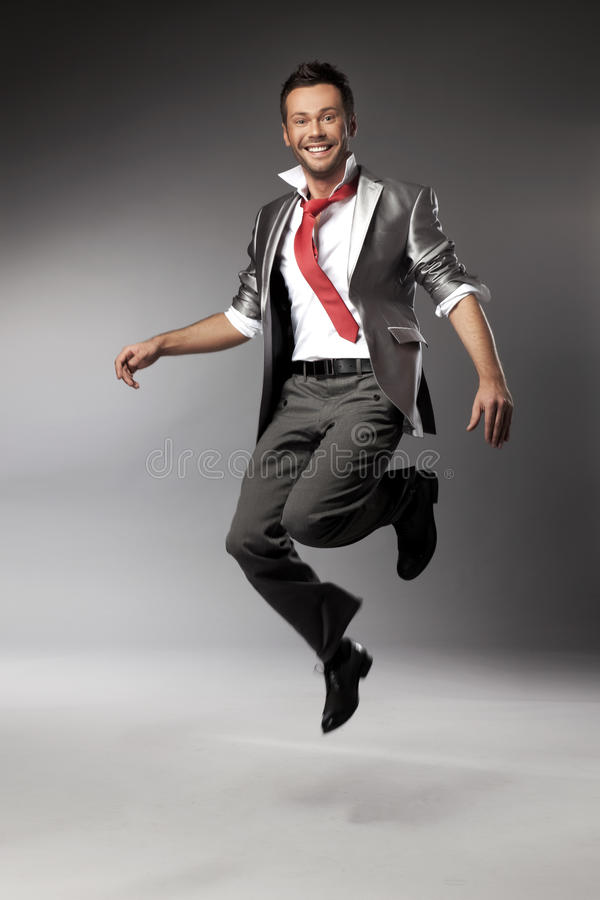 Happy man jumping stock photography