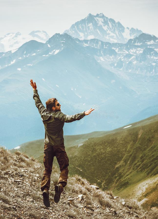 Happy Man jumping levitation in mountains Lifestyle Travel emotional stock photos