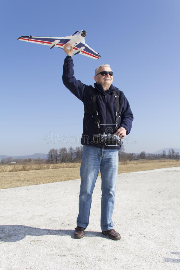 Happy Man Launching A RC Plane Royalty Free Stock Photography