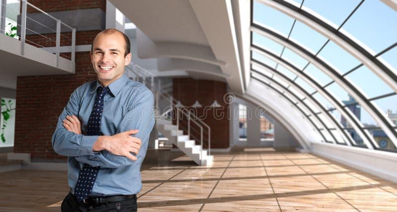 Happy man in a loft. Shot of a happy man in a modern luxurios loft royalty free stock image