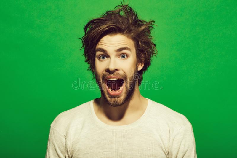 Happy man with long stylish uncombed hair, morning and barbershop stock image