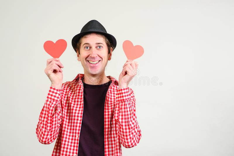 Happy man in love. Happy Valentines Day. Romantic guy holds valentine cards. Be my valentine. Boyfriend showing love fun affection royalty free stock photography