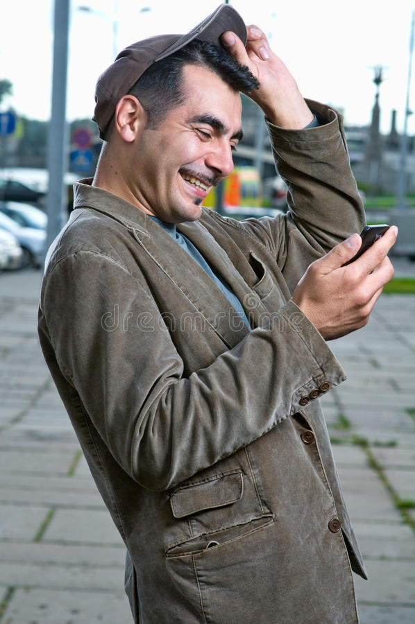 Download Happy Man With Mobile Phone Outdoors Stock Photo - Image: 15832566