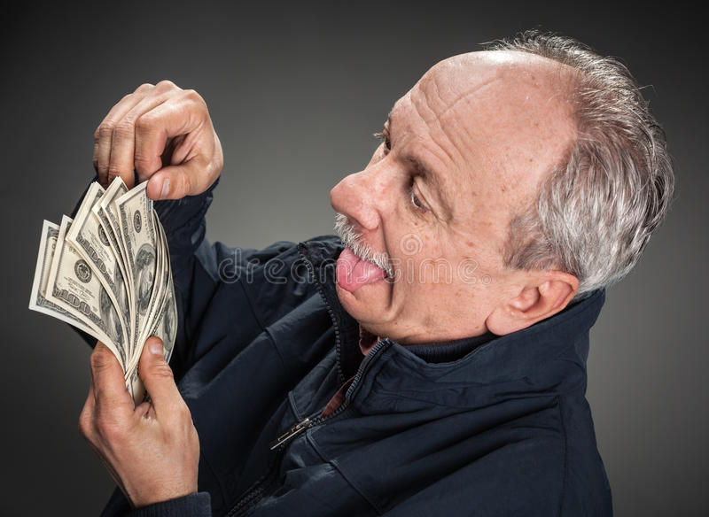Happy man with money. Greed. Happy man with money stock photography