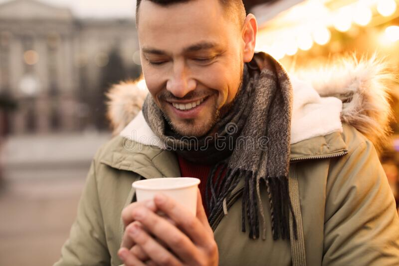 Happy man with mulled wine at  fair royalty free stock image