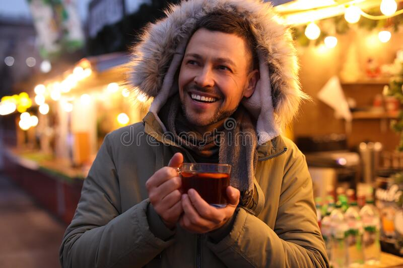 Happy man with mulled wine at fair royalty free stock photo
