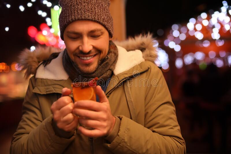 Happy man with mulled wine at fair royalty free stock images