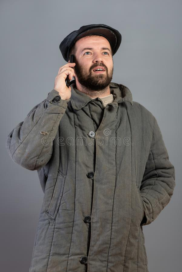 Caucasian man 35 years old with concentrated look at smartphone, studio shot. Idea - village dweller and modern technology. Set royalty free stock photos