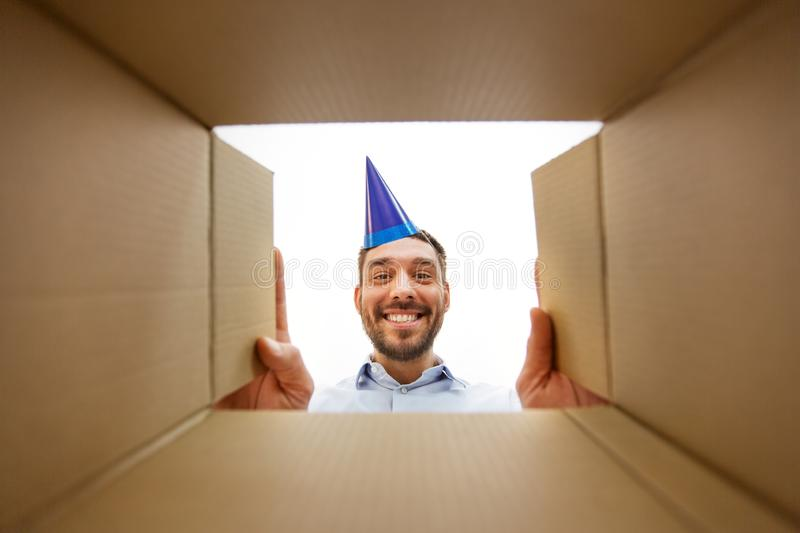 Happy man opening parcel box or birthday gift royalty free stock photo
