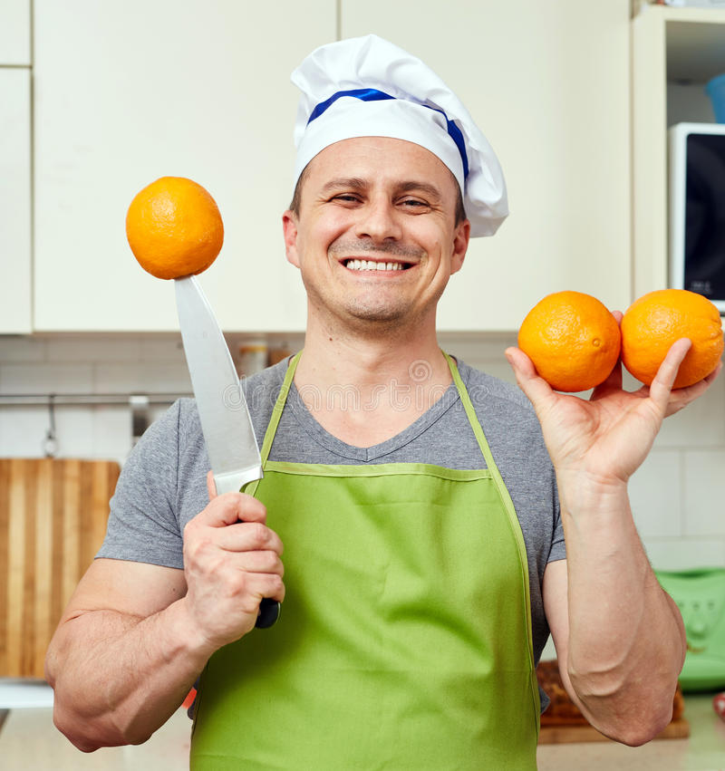 Happy man with oranges royalty free stock photo