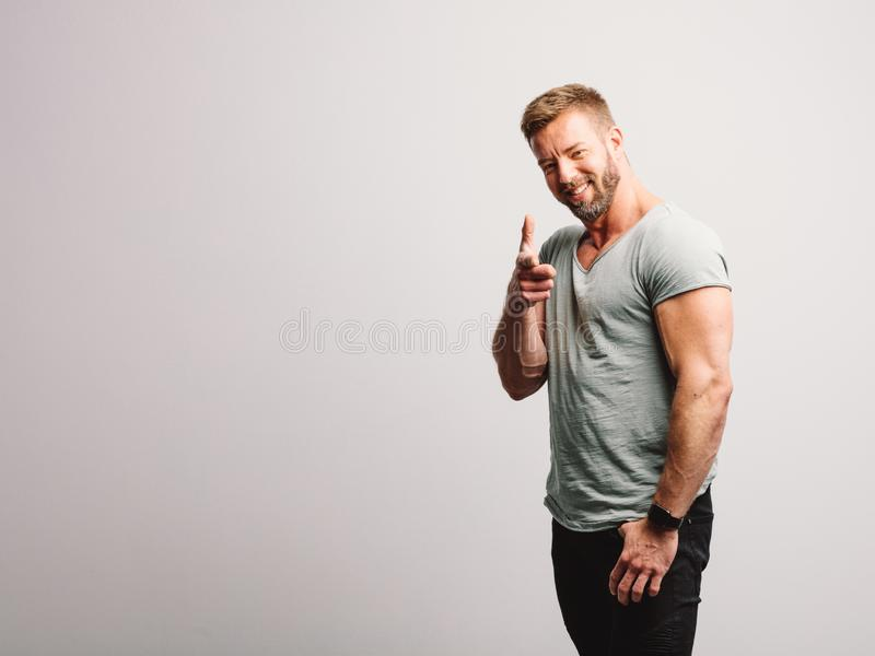 Happy man pointing his finger to the camera stock image