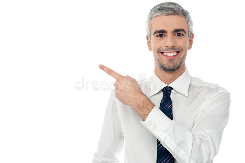 Download Happy Man Pointing At Something Stock Photo - Image of model, person: 38710688