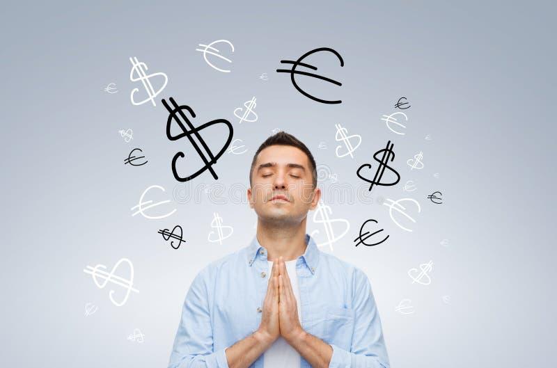 Happy man praying god for money stock image