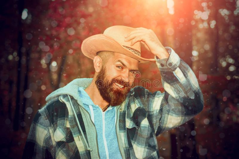 Happy man are preparing for autumn sunny day. Portrait of handsome funny man with beard. Fashion portrait of beautiful royalty free stock photography