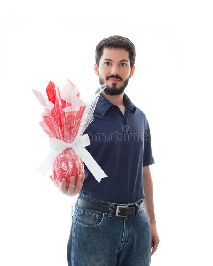 Happy man presents a beautiful chocolate easter egg. stock photos