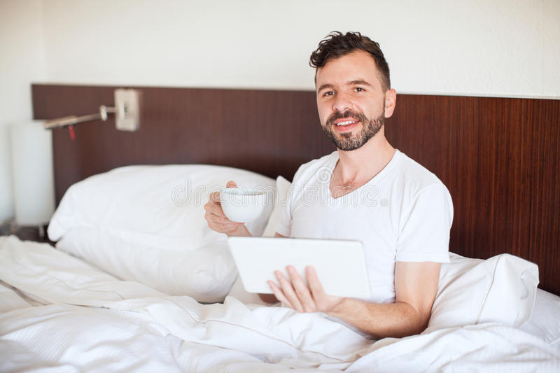 Happy man reading the news on a tablet royalty free stock photos