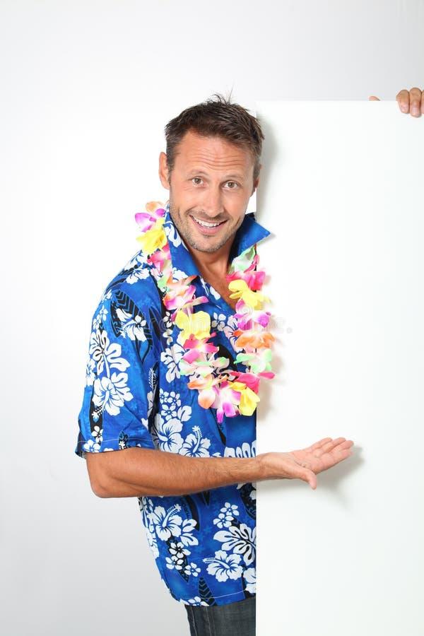 Happy man ready for tropical vacation stock photo