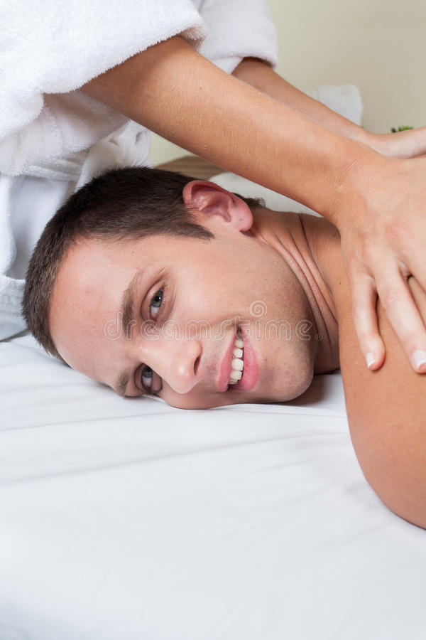 Happy man receiving a massage royalty free stock photos