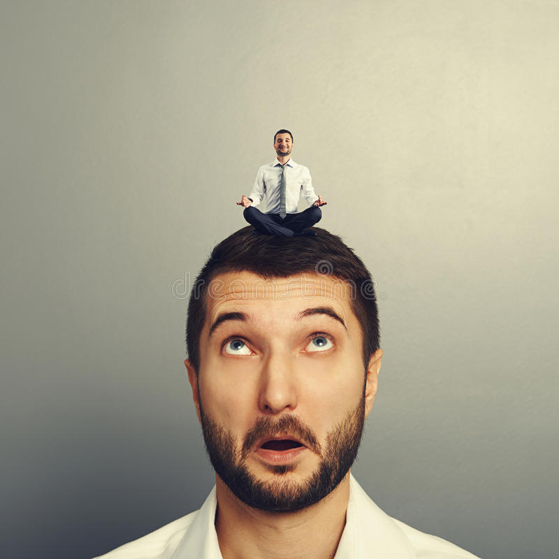 Happy man relaxing on the big head. Amazed man royalty free stock photo