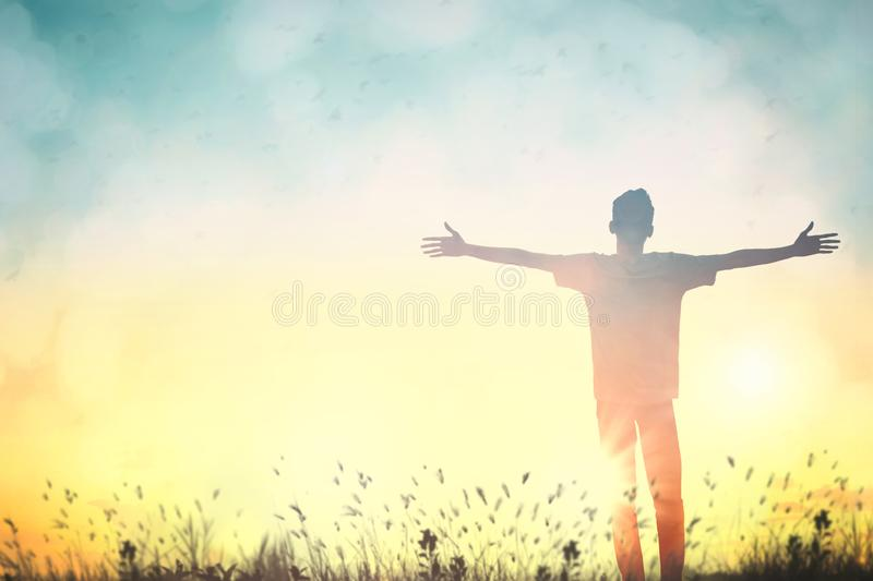 Happy man rise hand on morning view. Christian inspire praise God on good friday background. Male self confidence empowerment on stock photo