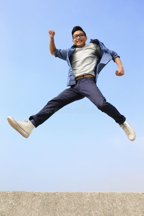 Happy man run and jump royalty free stock photos