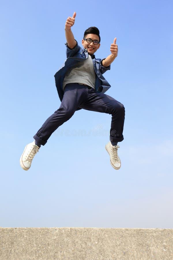 Happy man run and jump stock photo