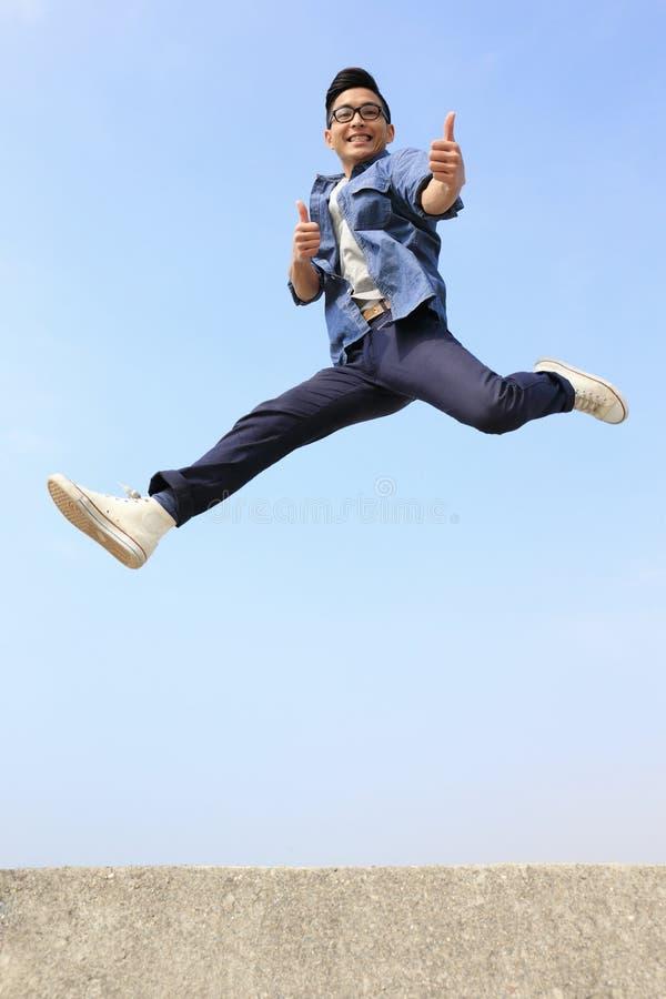 Happy man run and jump stock photos