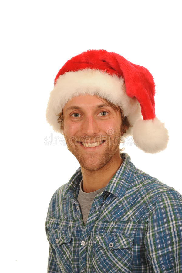 Happy man in Santa hat. Happy young man in check shirt with Santa hat; isolated on white background royalty free stock photo