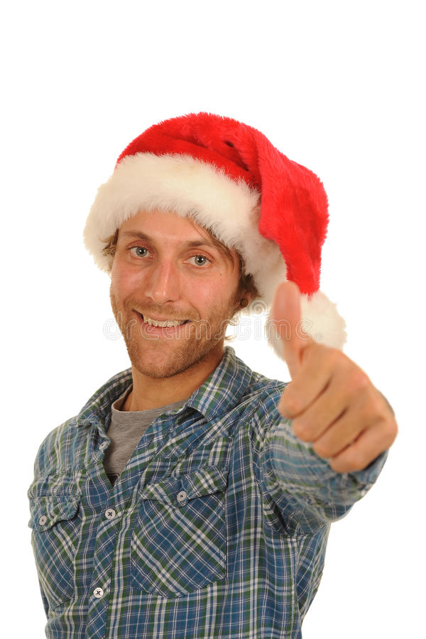Happy man in Santa hat. With thumb up; isolated on white background stock images