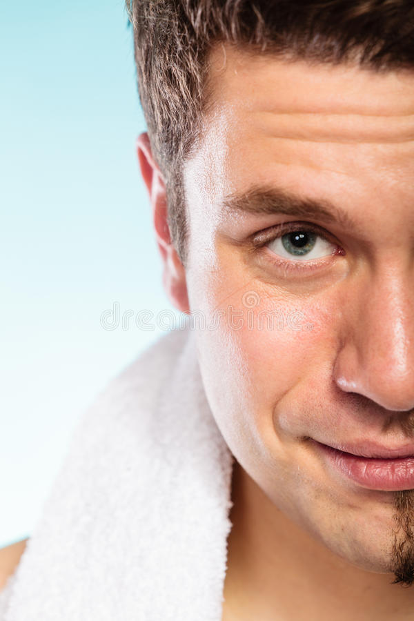 Happy man shaved face beard hair. Happy man with shaved face beard hair. Smiling handsome guy on blue. Skin care and hygiene royalty free stock photos