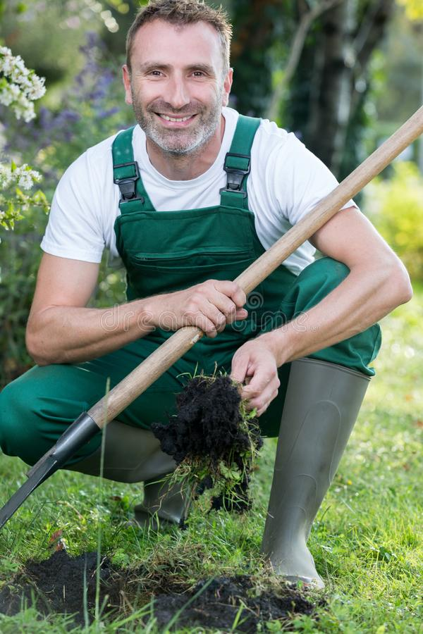 Happy man with shovel in garden royalty free stock images
