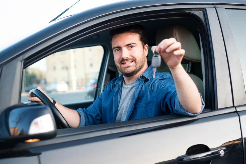 Cheerful man happy after buying new car royalty free stock images