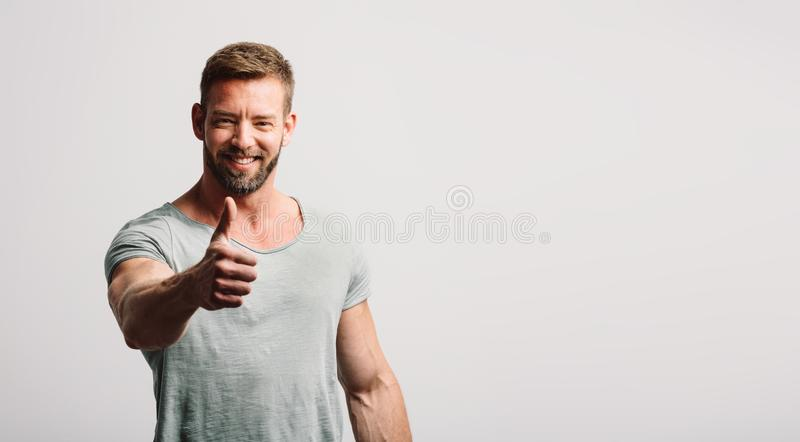 Happy man showing OK gesture and smiling stock photo