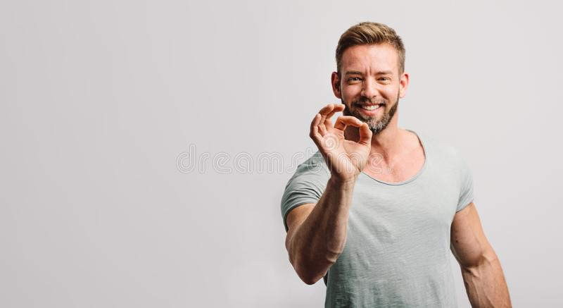 Happy man showing OK gesture and smiling royalty free stock photos