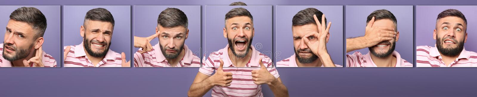 Happy man showing thumb-ups gesture on color background royalty free stock images