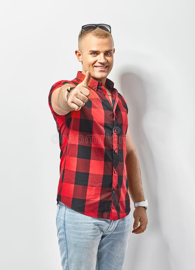 Happy man showing thumbs up sign royalty free stock photos